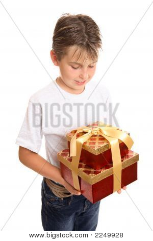 Child Holding Stack Of Presents