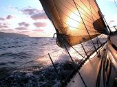 stock photo of sail ship  - sailing to the sunrise - JPG