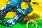 Carnival mask on brazilian flag background poster