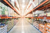 Blurred Wholesale Store With Big Boxes Of Product From Floor To Ceiling poster