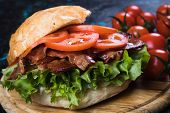 BLT sandwich with fried bacon, lettuce and tomato in slices of bread poster