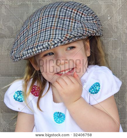 Young girl wearing flatcap