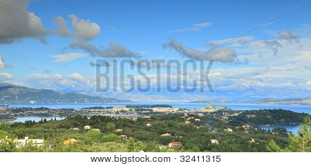 A view across Corfu town in autumn, with the hills of northern Kerkyra (Corfu) on the left and the hills of Albania and mainland Greece in the distance.