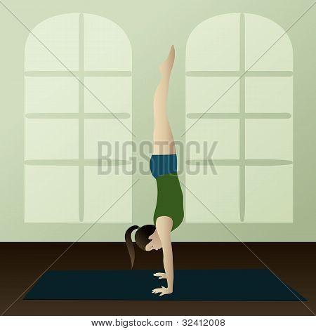 Young Woman Practicing Yoga Adho Mukha Vrksasana(handstand )
