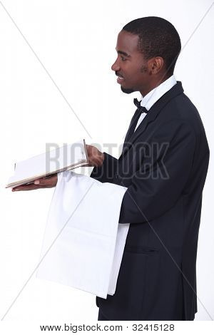 black waiter giving the bill
