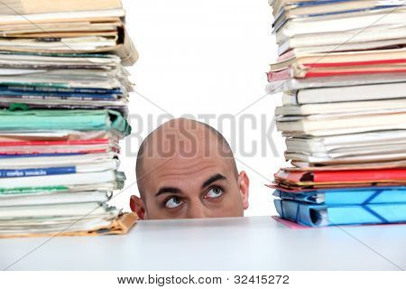 Man peering at files