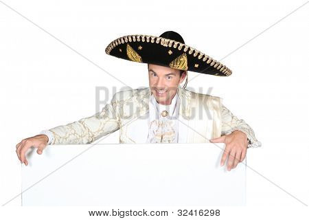 Man in a mariachi costume  with a board left blank for your  message
