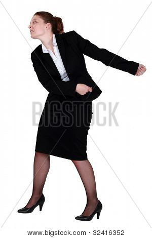 Businesswoman pulling an invisible chain