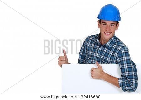 Construction worker approving a board left blank for your message
