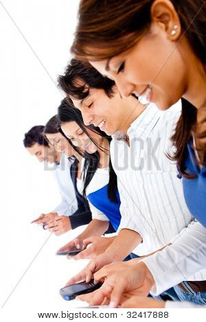 Group of young people texting on their phones - isolated over white