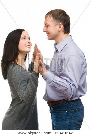 Portrait of a happy man surprising his wife by covering her eyes