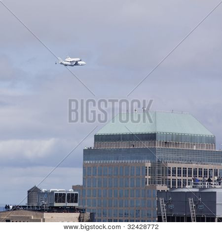 NEW YORK - Oct 8: Space shuttle Enterprise mounted on NASA's 747 Shuttle Carrier Aircraft flies north along the Hudson River with 3 World Financial Center in the foreground on October 8, 2011 in NYC.
