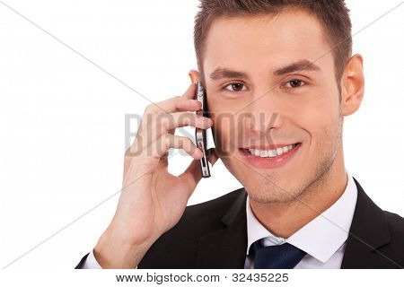 Close up of a happy business man making a phone call against a white background
