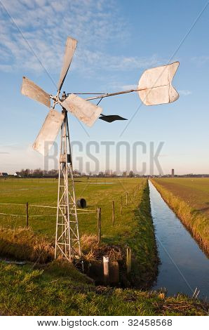 Metal Windmill Controls The Water Level In The Ditch