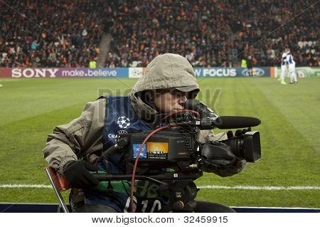 Unidentified Cameraman Working