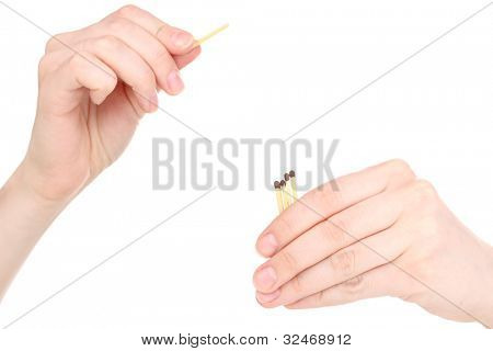 Hand throwing match isolated on white
