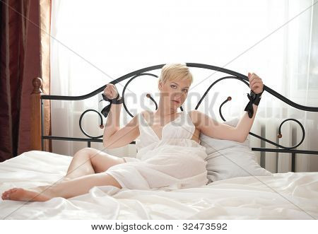 woman bondage on the bed