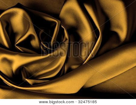 Smooth elegant dark gold satin background.