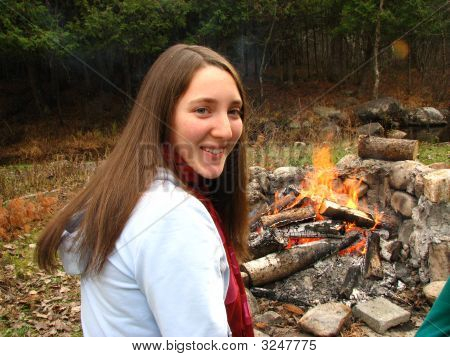 Happy Woman Next To Fire