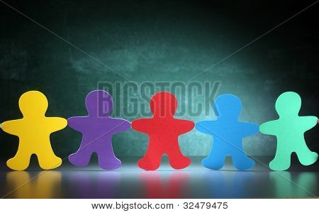 multi color paper cut-out men in a row