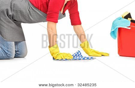Female cleaner wiping down and bucket with cleaning supplies isolated on white background