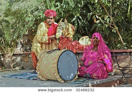 Colorful Couple Travelling Puppetier Musician