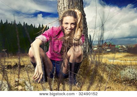 Fashion Portrait Of Young Beautiful Woman In Nature