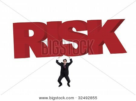 Businessman Carrying A Huge Risk Sign