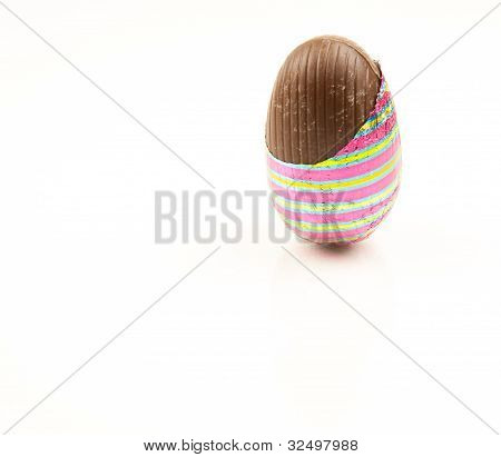 Chocolate easter egg partially unwrapped