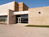 picture of school building  - exterior gymnasium entrance for a school building - JPG