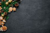 Christmas Background With Homemade Gingerbread Cookies, Evergreen Branches And Decorations On Black  poster