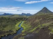 Volcanic Landscape Of Green Storasula Mountain With Lush Moss And Blue Creek Water Between Emstrur A poster