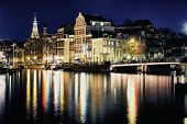 stock photo of bridge  - portrait of an amsterdam bridge by night - JPG