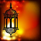 stock photo of kareem  - Intricate arabic lamp with lights on the wave and grungy background for Ramadan Kareem and other events - JPG