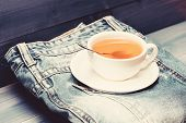 Herbal Green Or Black Whole Leaf. Mug Filled Boiling Water And Tea Bag On Blue Jeans Background. Hea poster
