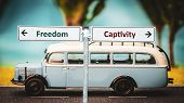 Street Sign The Direction Way To Freedom Versus Captivity poster