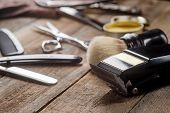 Electric Clipper On The Wooden Surface, Macro. Brush, Scissors, Wax, A Comb, A Straight Razor On The poster