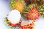 Opened Rambutan Fruit Or Hairy Fruit On White Background. poster