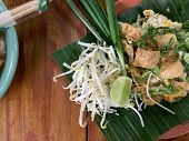 Pad Thai. Thai Style Fried Noodles With Shrimps Prawns And Vegetables On Banana Leaf On Wooden Table poster