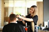 Blonde Hairdresser Shaving Man By Electric Razor. Woman Hairstylist Using Shaver And Hairbrush For S poster