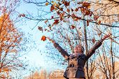 Fall Activities. Middle-aged Woman Throwing Leaves In Autumn Forest. Senior Woman Having Fun Outdoor poster