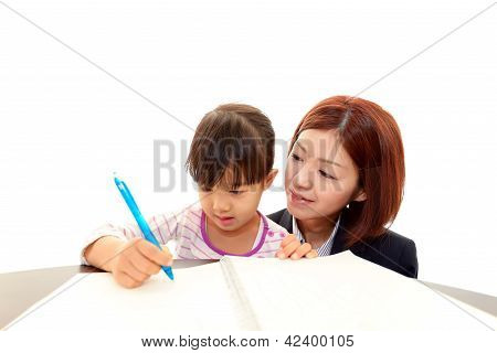 Teacher with little girl studying.