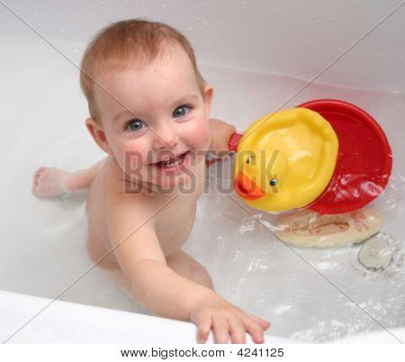 The Child Bathing In A Bath
