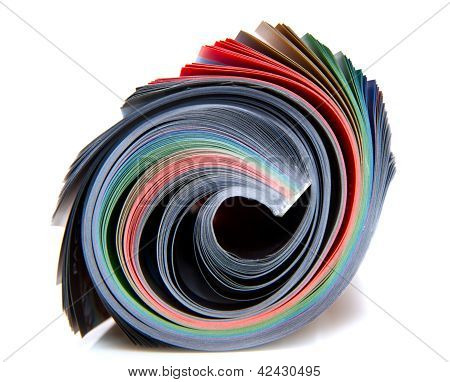 Rolled up magazine on white