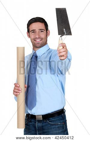 Engineer holding a trowel and a rolled-up drawing