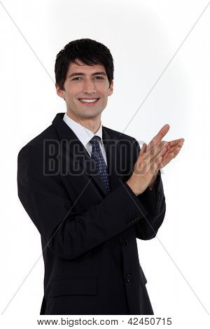 Smiling businessman clapping his hands