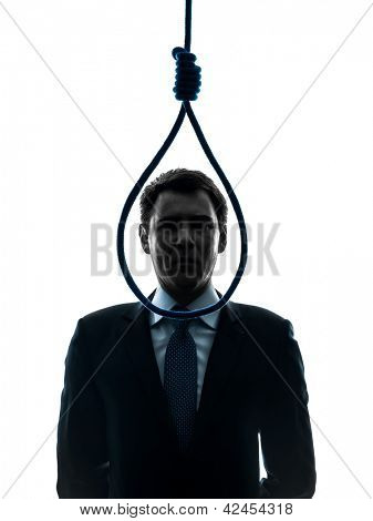 one caucasian business man standing in front of hangman's noose in silhouette studio isolated on white background