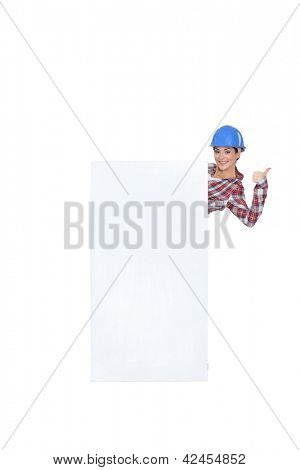 craftswoman presenting an ad board and making a thumbs up sign