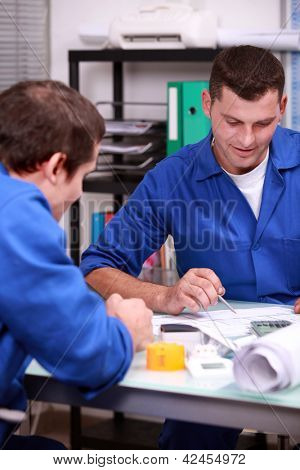 Two warehouse managers checking stock