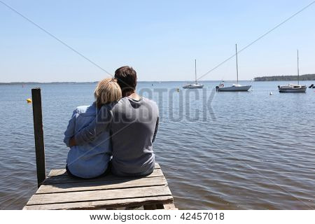 Couple sitting on a pontoon